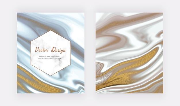 Graue und schwarze flüssige tinte mit goldener glitzertextur.
