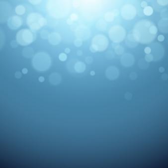 Grauer hintergrund mit defokussierten lichtern