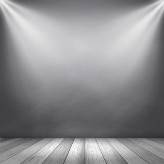 Grauer hintergrundinnenraum mit den scheinwerfern, die unten für anzeigenprodukte glänzen