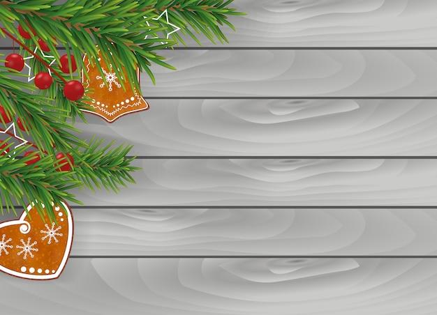 Grauer weihnachtshintergrund des holzes mit lebkuchenplätzchen
