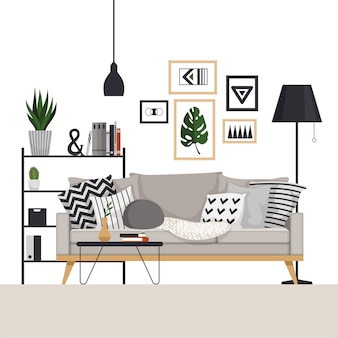 Graues sofa mit couchtisch und gestell mit stehlampe im skandinavischen stil. mit bildern, pflanzen und kissen. teil des wohnzimmers.