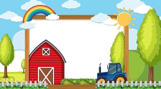 Grenze mit traktor und scheune im hintergrund