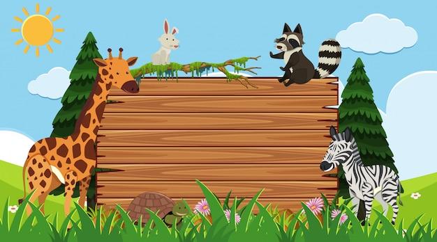 Grenzschablone mit wilden tieren im hintergrund