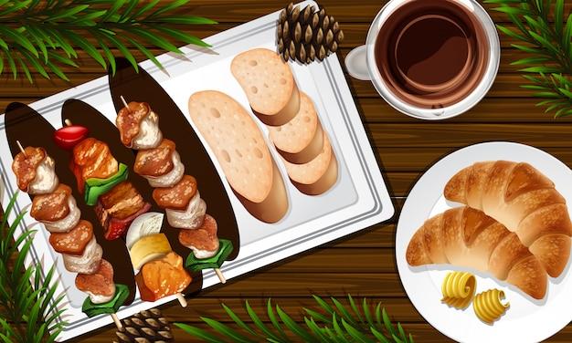 Grillen und pfannkuchen schließen oben auf schreibtischhintergrund mit einigen blattstützen
