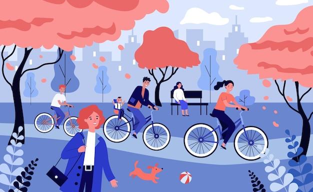 Große familie, die fahrrad im schönen park reitet