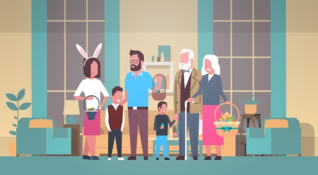 Große familie feiern fröhliche ostern, die korb mit eiern halten und bunny ears over home interior tragen