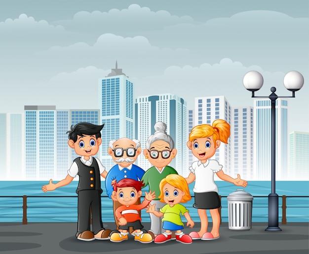 Große glückliche familie, die am flussufer über den städten steht