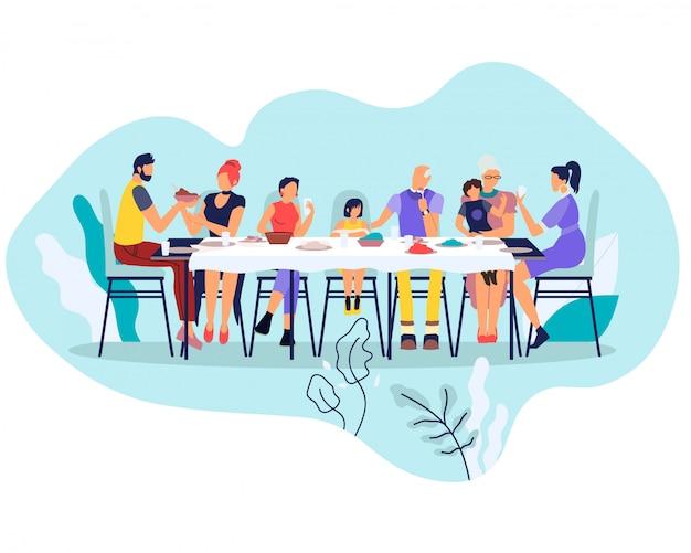 Große glückliche familie, die am tisch mit gerichten sitzt