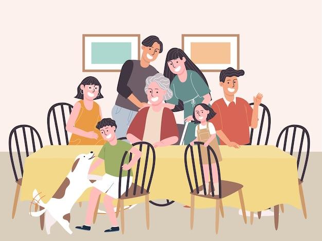 Große glückliche familie, die auf esstisch lächelt