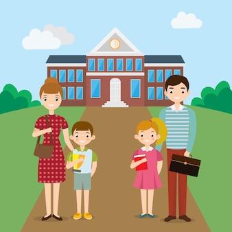 Große glückliche familie vor dem schulgebäude