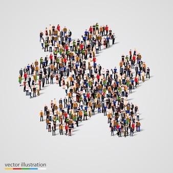 Große gruppe von menschen, die die form eines puzzles bilden