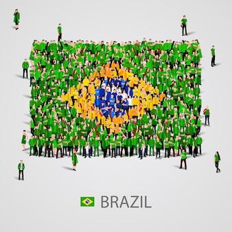 Große gruppe von menschen in form der brasilianischen flagge