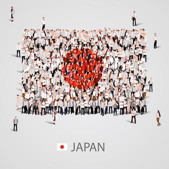 Große gruppe von menschen in form der japanischen flagge