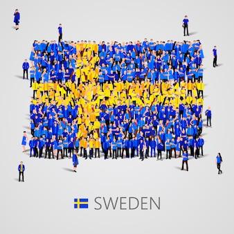 Große gruppe von menschen in form der schwedischen flagge