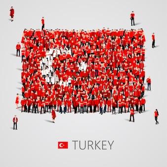 Große gruppe von menschen in form der türkischen flagge