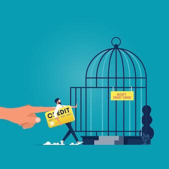 Große hand schieben geschäftsmann mit kreditkarte in vogelkäfig metapher der schulden