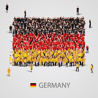 Große menschengruppe in form der deutschlandflagge