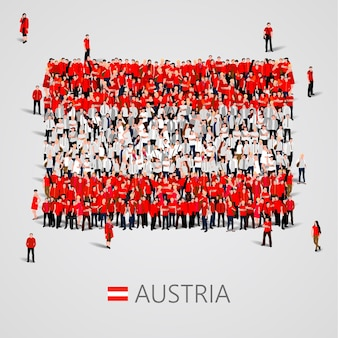 Große menschengruppe in form der österreich-flagge