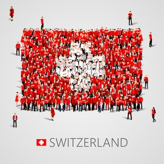 Große menschengruppe in form einer schweizer flagge