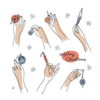 Große reihe von weiblichen händen, die weihnachtskugeln und kugeln halten, handgezeichnete vektorillustration in einer linie...