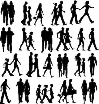 Große sammlung von silhouetten von menschen zu fuß