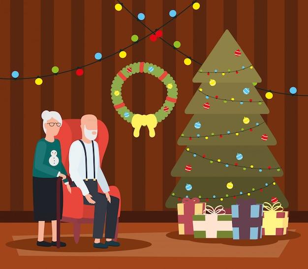 Großelternpaare im wohnzimmer mit weihnachtsdekoration