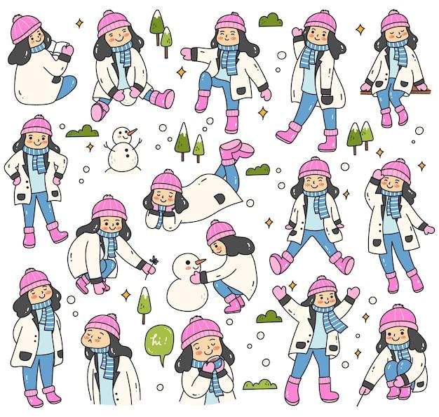 Großes set von kleinen mädchen-karikaturen, die im schnee spielen