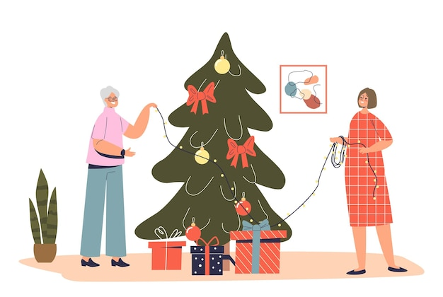 Großmutter der älteren dame, die zusammen mit der enkelin den weihnachtsbaum schmückt