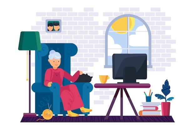 Großmutter, die im wohnzimmer fernsieht