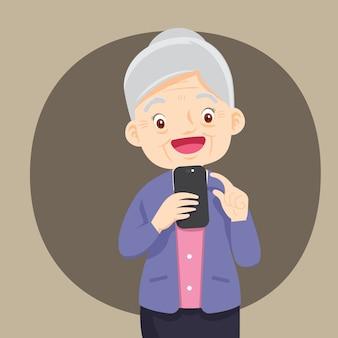 Großmutter hält ein telefon in der hand