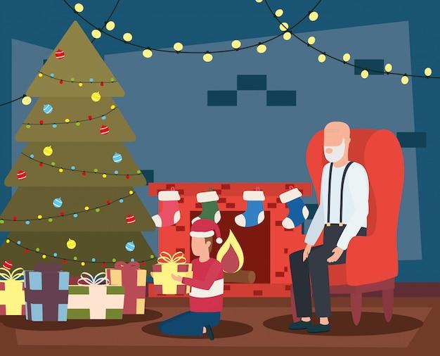 Großvater und enkel, die weihnachten im wohnzimmer mit baum feiern