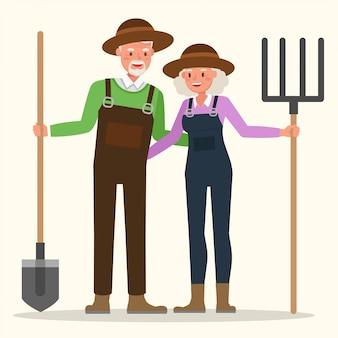 Großvater und großmutter arbeiten gemeinsam im garten.