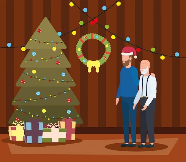 Großvater und sohn im wohnzimmer mit weihnachtsdekoration
