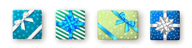 Grüne, blaue geschenkbox mit band und schleife, ansicht von oben. weihnachten, silvesterparty, alles gute zum geburtstag, vatertag oder osterpaketdesign. geschenk isoliert auf weißem hintergrund. vektor.