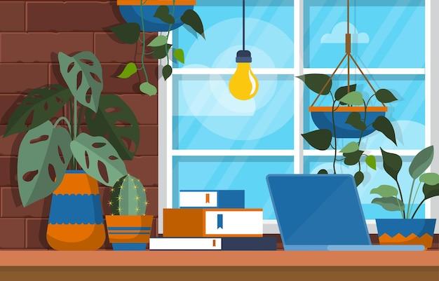 Grüne dekorative pflanze der tropischen zimmerpflanze im büroarbeitsbereich