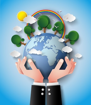 Grüne eco erde und hand.