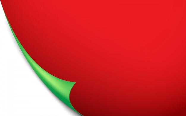 Grüne gekräuselte ecke des roten papierhintergrundes