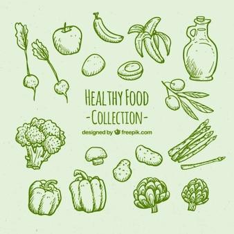 Grüne hand gesunde lebensmittel satz gezeichnet