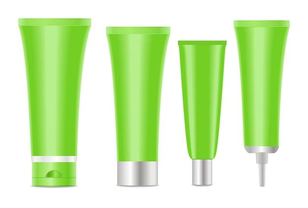 Grüne leere kosmetische gefäße auf weiß. vektor