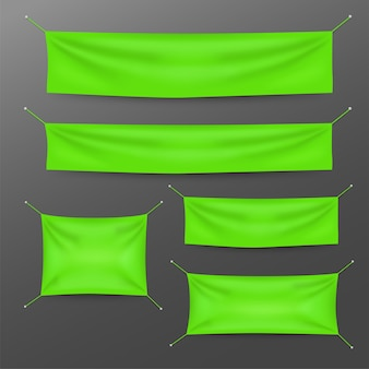 Grüne textilfahnen mit faltenschablonensatz