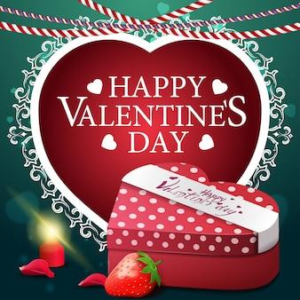 Grüne valentinstaggrußkarte mit geschenk und erdbeere