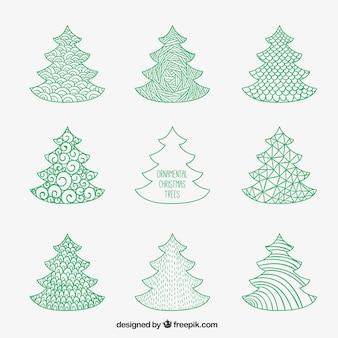 Grüne weihnachtsbäume in der hand dran stil