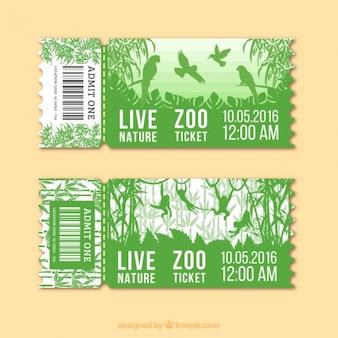 Grüne zoo-tickets mit vögeln und affen