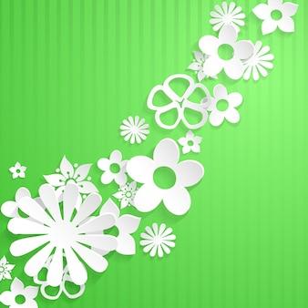 Grüner hintergrund mit weißen blumen aus papier geschnitten