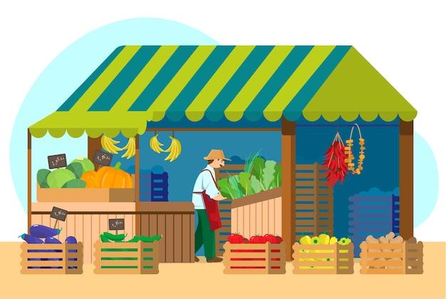 Grüner lebensmittelmarkt mit verkäufer. straßenstand mit obst und gemüse.