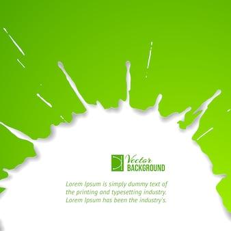 Grüner tropfen über weiß.
