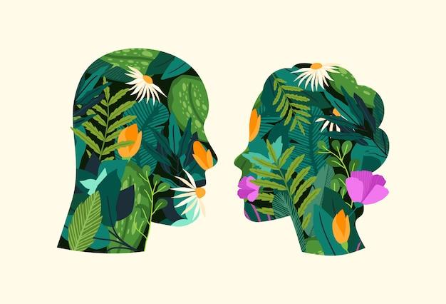 Grünes denken. in ihnen wachsen silhouetten von mann und frau mit blumen.