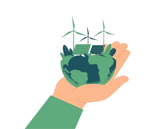 Grünes energiekonzept. sonnenkollektoren und windturbinen auf dem planeten erde. die menschliche hand hält eine grüne welt.