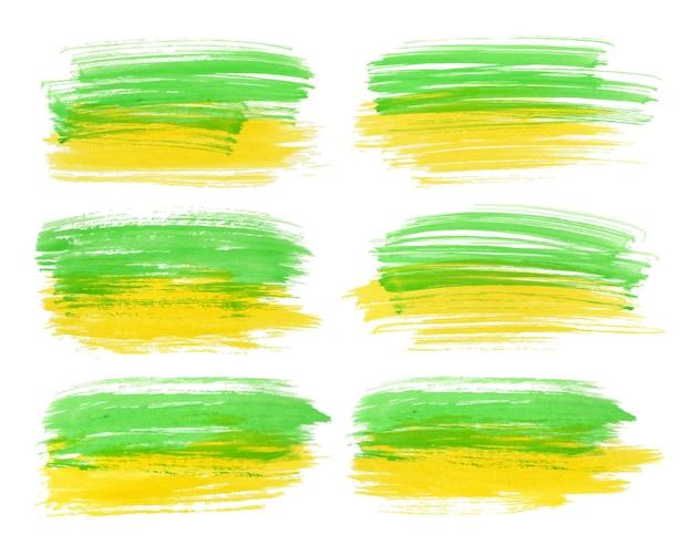 Grünes gelbes aquarellpinselstrichset