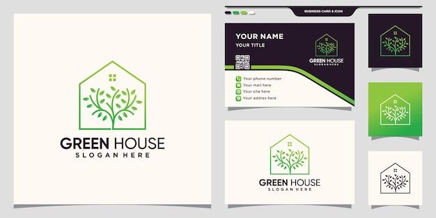 Grünes haus und baumlogo mit kreativem konzept und visitenkartendesign premium-vektor